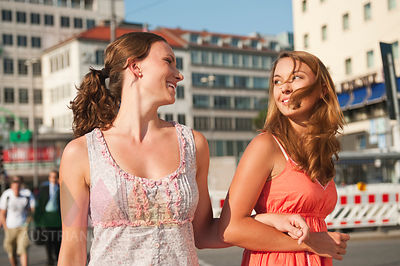 Germany, Munich, Karlsplatz, Young women smiling and having fun together