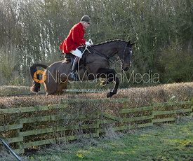 Andrew Osborne jumping a hedge at Town Park Farm - The Cottesmore at Town Park Farm