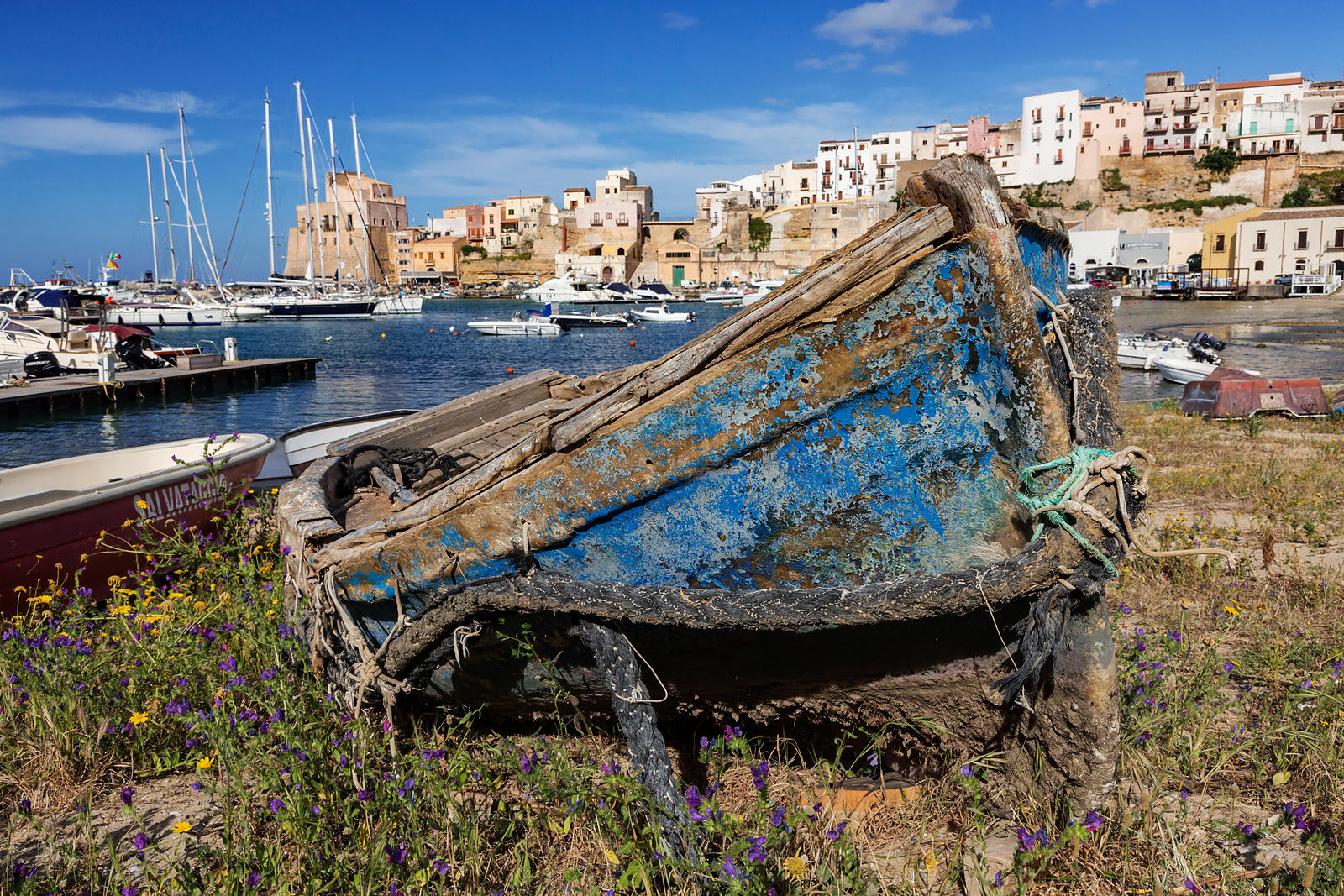 Old Boat Moored on the Shore of the Harbour
