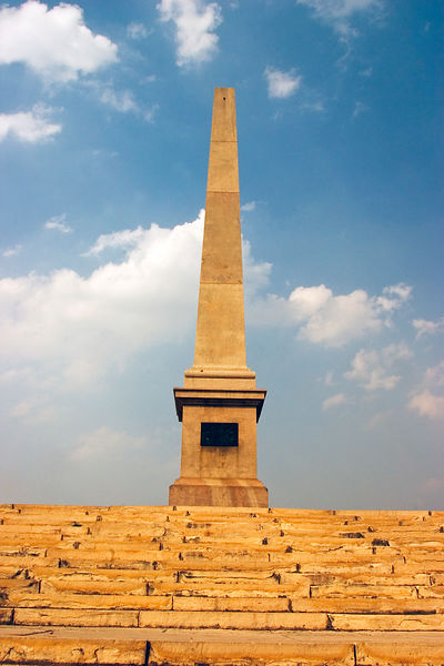 India - Delhi - The obelisk that marks the site of the coronation on King George V of Great Britain where he proclaimed himself Emporer of India.