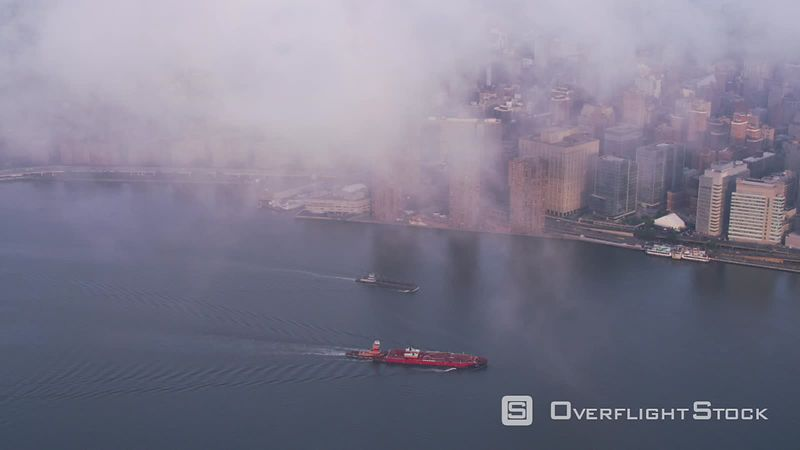 New York City Aerial view of barges on the Hudson River.  Shot with Cineflex and RED EpicW Helium.