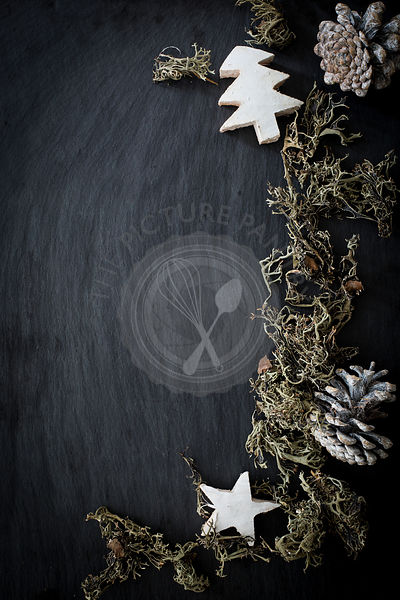 Christmas/winter decoration on slate background. Top view