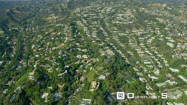 Red Epic Video residences in the Beverly Hills area Los Angeles California USA. Bird Streets. Extremely rare view of the Hollywood Hills with lush green vegetation after winter rains!
