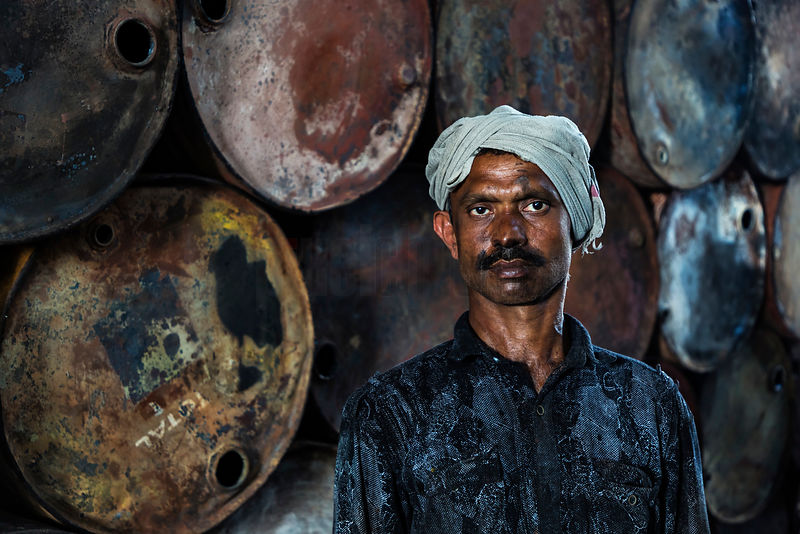 Worker in Oil Drum Recycling Facility
