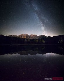Milky way over Lake Carezza in the Dolomites