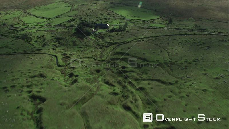 Aerial view tracking over Whiteworks hamlet, showing evidence of past mining, Dartmoor National Park, Devon, England, UK, October 2015.