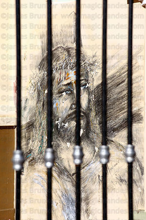Mural of Jesus seen through railings , Tarija , Bolivia