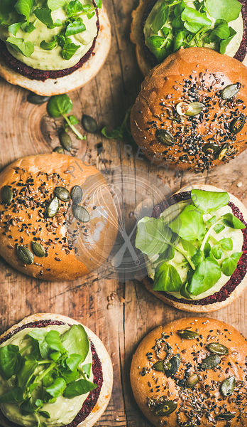 Flat-lay of healthy vegan burgers with beetroot patties, close-up