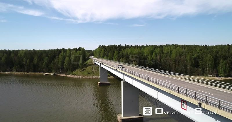 Car, Bridge, Aerial Reverse View of a Vehicle Driving Over a Bridge, Sunny Summer Day, Kemionsaari Archipelago, Finland