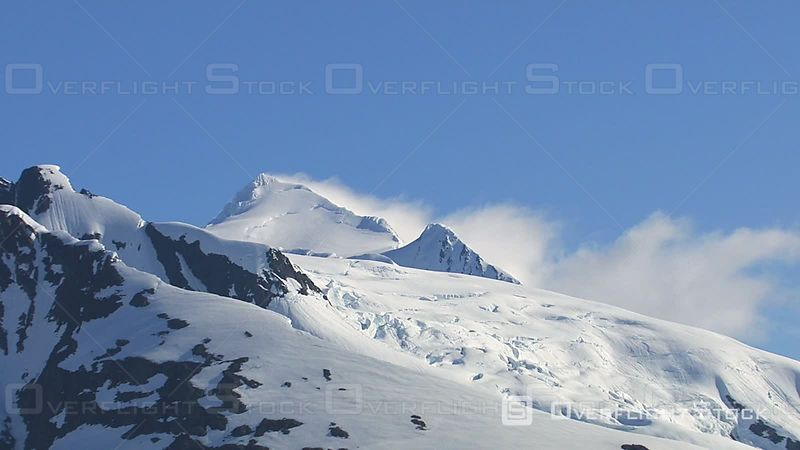 Zoom Out from Snowy Mountain Peak, Alaska