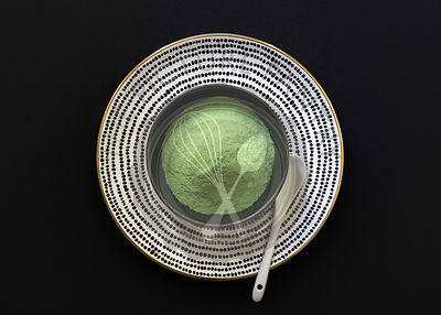 Matcha tea powder in a bowl.