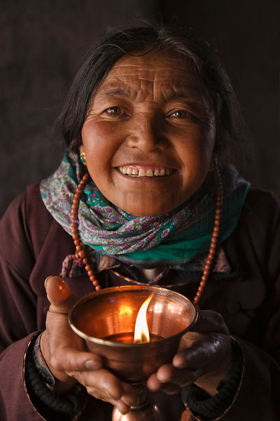 Ladakhi Woman Placing Cup of Burning Cooking Oil as Offering
