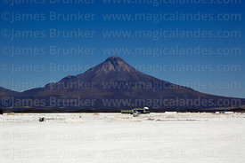 Salt collection truck and Tata Sabaya volcano, Salar de Coipasa, Oruro Department, Bolivia