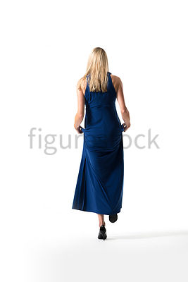 A Figurestock image of a blonde woman in a blue evening dress, walking up some steps - shot from low level.
