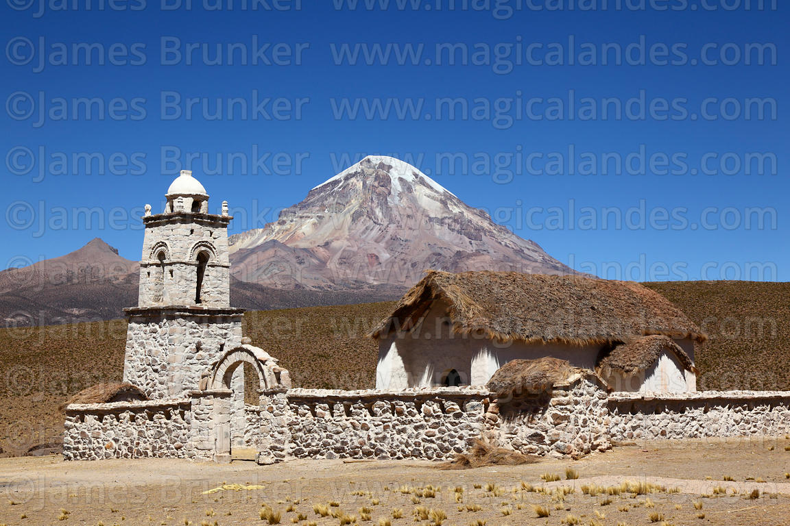 Restored church at Cotasaya and Sajama volcano, Sajama National Park, Bolivia