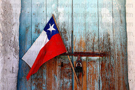 Chilean flag on rustic church door , Guallatiri , Region XV , Chile