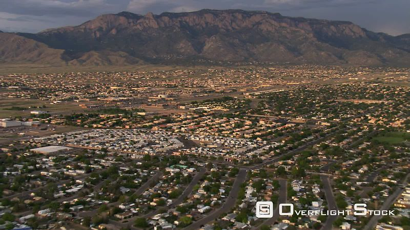 Fast flight over Albuquerque suburbs toward Sandia Mountains.