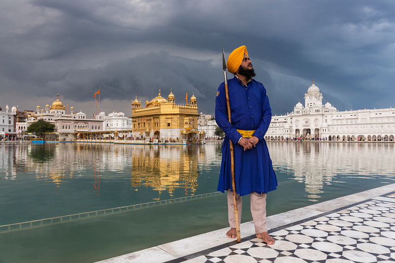 A Nihang Sikh Stands Guard at the Golden Temple (Harmandir Sahib) in Amritsar