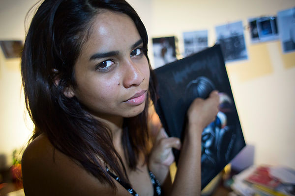 Laura, 22, is Sikuani by her mother and is a victim of the civil war. In Bogota since 3 years, she discovered ways to express her story through art and in particular through performances, Bogota, Colombia
