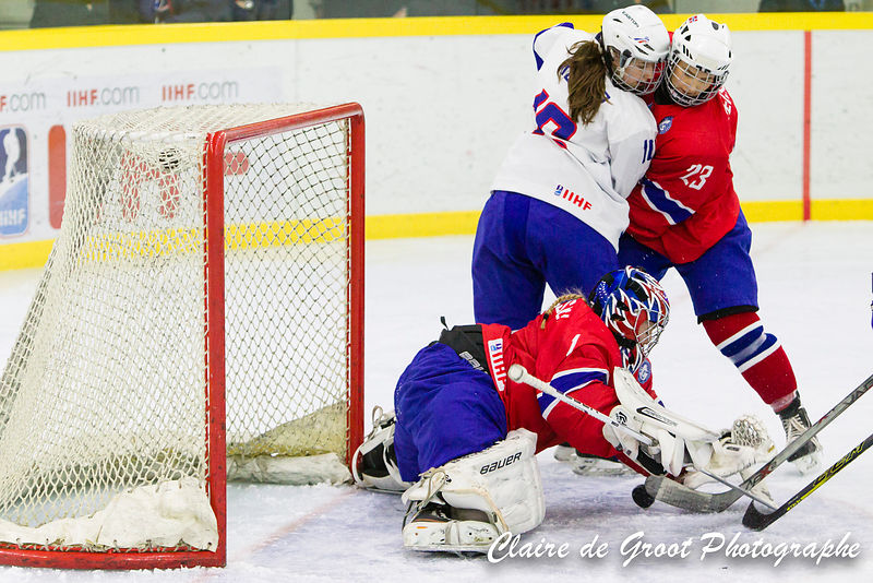 Norwegian goalie no 1 Emilie KRISTIANSEN makes a save as French no 16 Clara Rosier and Norwegian no 23 Julie OISETH look on.