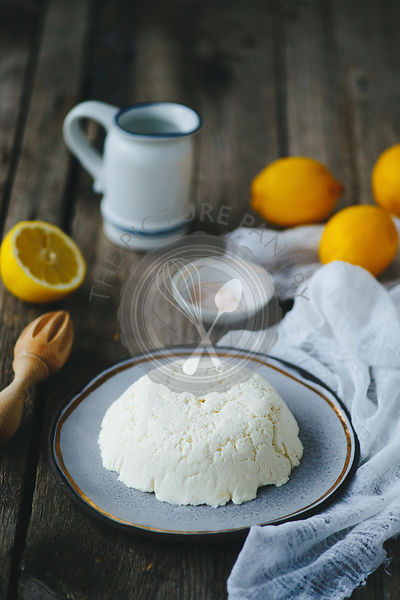 Homemade ricotta on a wooden table