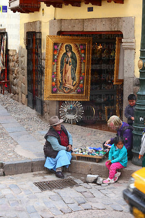 Tourist looking at gemstones for sale on street stall, Cusco, Peru