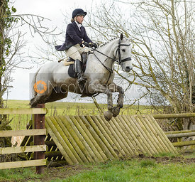 Emma Hyslop-Webb jumping a fence at Peake's Covert