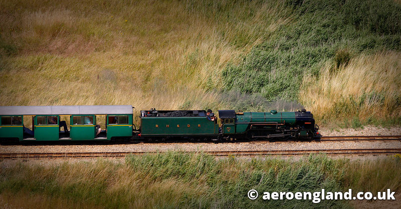 aerial photograph of the steam locomotive Typhoon on the The Romney, Hythe & Dymchurch Railway  Kent England UK