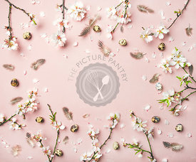 Easter background with eggs, almond flowers and feathers, copy space