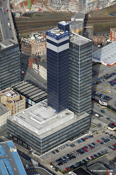aerial photograph of the CIS building in Manchester showing its new solar panel cladding