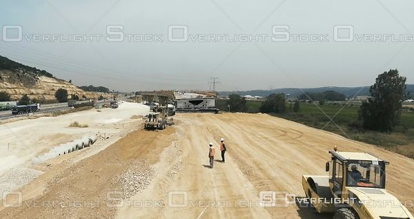 Workers and Heavy Equipment at a Highway and Overpass Construction Project Israel