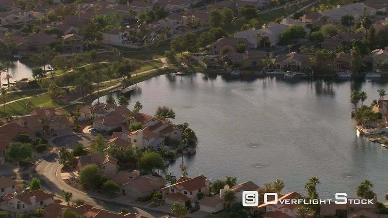 Flight over wealthy residential area on lakefront near Phoenix.