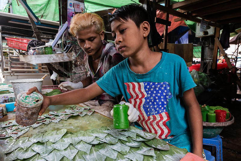 Young Men Preparing the Wads of Betel Nut for Chewing