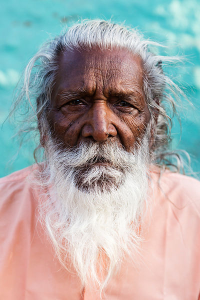 Portrait of a Sadhu Against a Blue Wall