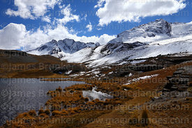 Fresh snowfall on mountains around Lake Pampalarama, Cordillera Real, Bolivia