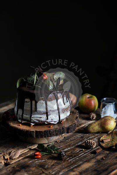Autumn mood: chocolate & pear cake on wooden table