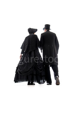 A mystery Victorian couple walking away – shot from low level.