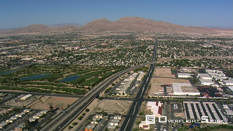 Flying over outlying Las Vegas above I-15 and Las Vegas Boulevard.