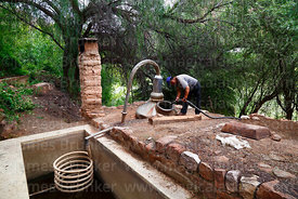 Worker cleaning a traditional still for making singani, Villa Abecia, Chuquisaca Department, Bolivia