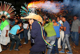 Man with fireworks exploding on his hat runs into crowd, San Ignacio de Moxos, Bolivia