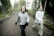 Women walking on forest dirt road