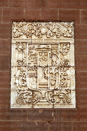 Alabaster tablet of coat of arms of Bishop Bernardo Serrada on entrance facade of the Temple of Triumph / Templo del Triunfo, Cusco, Peru