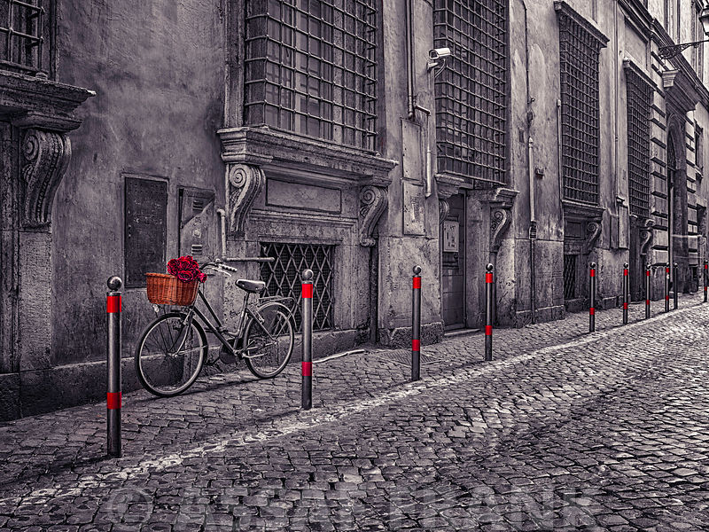 Bunch of roses on bicycle on old city street of Rome