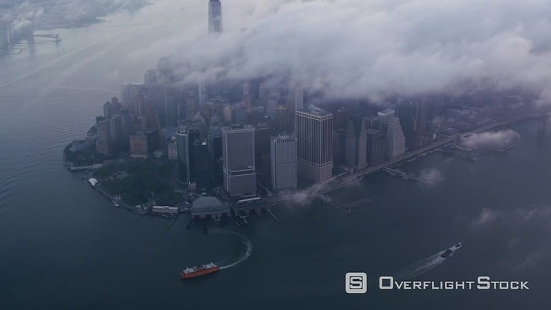 New York City High angle aerial view of lower Manhattan with low clouds.  Shot with Cineflex and RED EpicW Helium.