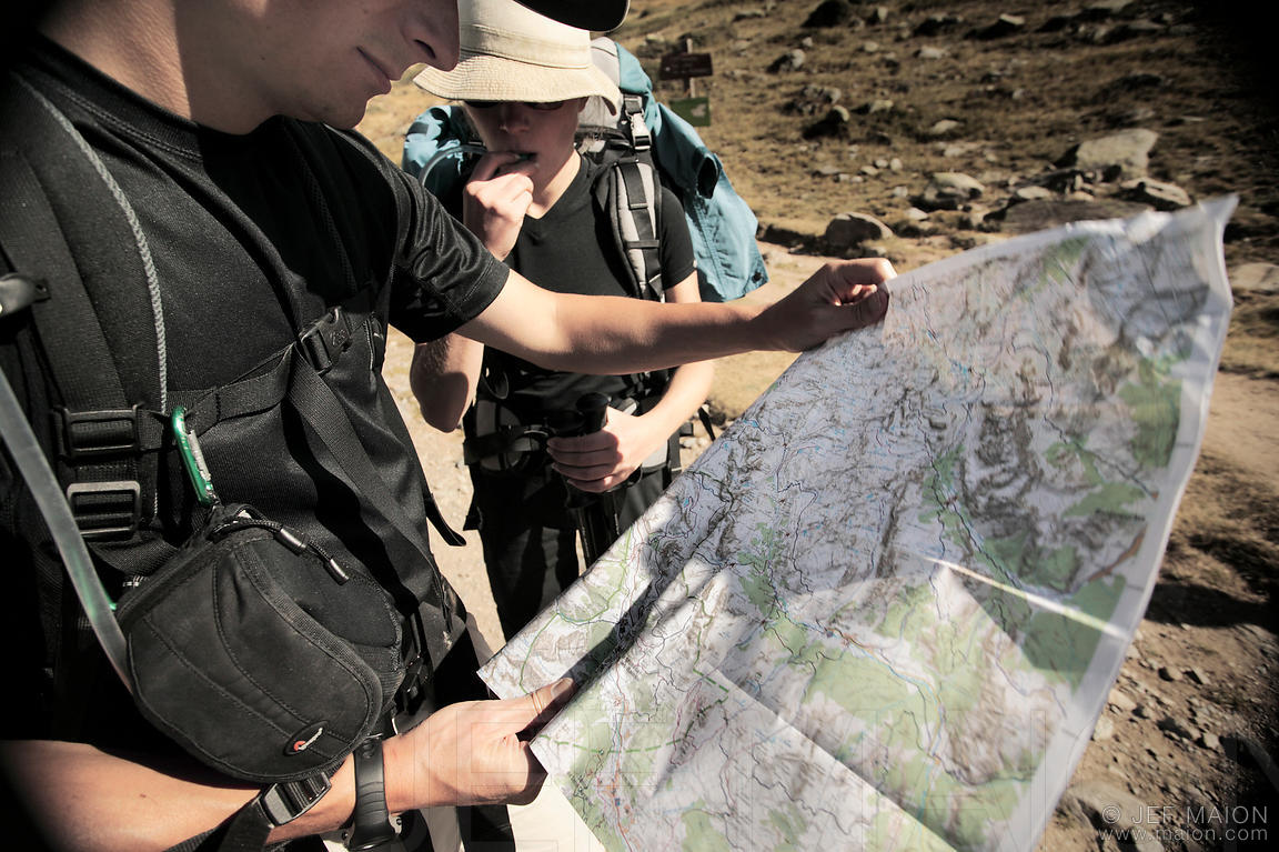 backpackers looking at map