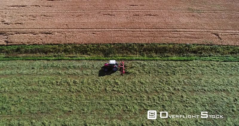 Plow Tractor, 4k Aerial View Following a Plowing Machine, Harvesting, Grass Field, Sunny Autumn Day, Uusimaa, Finland
