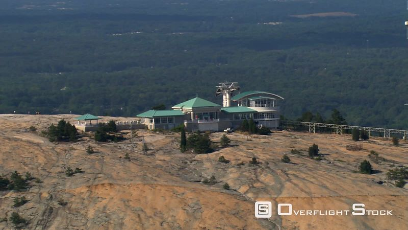Aerial zoom-out from top of Stone Mountain, Georgia.
