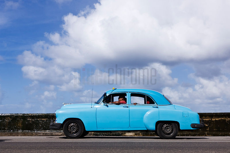 Vintage Car Driving on the Malecon