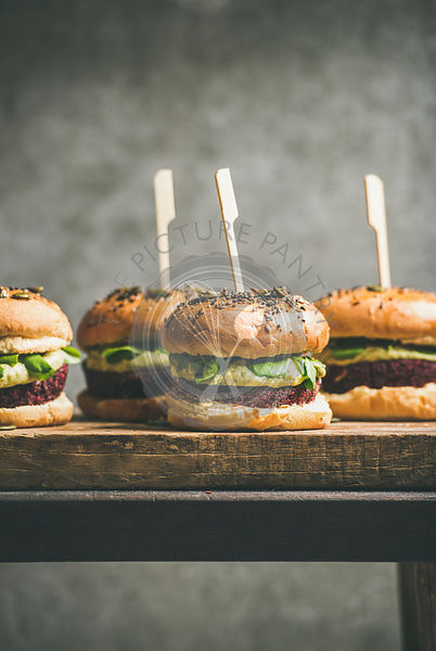 Vegan burgers with beetroot patties and green sprouts
