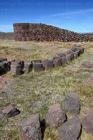 Unfinished cut stone Inca period chulpa / burial tower with construction ramp, Sillustani, Peru